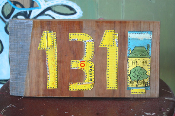 Worker Bird 131 house numbers sign