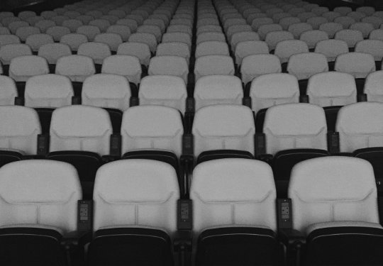 Vintage movie theater seats in black and white